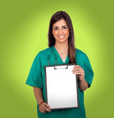 Atractive medical with a blank paper on clipboard — Stock Photo