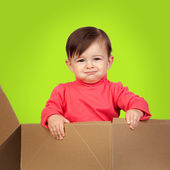 Adorable baby out of a package — Stock Photo