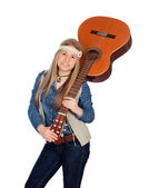 Pretty girl with hippie clothes and a guitar — Stock Photo