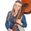Stock Photo: Pretty girl with hippie clothes and a guitar