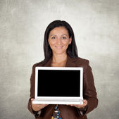 Brunette businesswoman with a laptop — Stock Photo