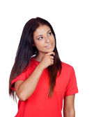 Pensive brunette girl dressed in red — Stock Photo