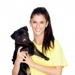 Brunette girl with her pug dog — Stock Photo #27183601