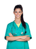 Attractive woman doctor with green uniform — Stock Photo