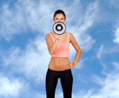 Attractive girl with fitness clothing and megaphone — Stock Photo