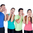 Happy friends with colored sportswear shouting — Stock Photo