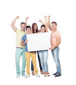 Group of young people with a blank poster — Stok fotoğraf