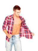 Young man with unbuttoned plaid shirt — Stock Photo