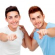 Couple of best friends pointing to the front — Stock Photo #31204547