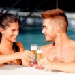 Happy couple relaxing in the pool — Stock Photo #31204647