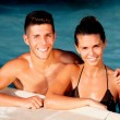 Happy couple relaxing in the pool — Stock Photo #31204743