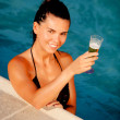 Attractive girl with a glass of champagne — ストック写真