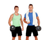 Personal trainer and strong boy with dumbbels — Stock Photo