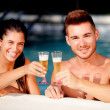 Happy couple relaxing in the pool in the summer — Stock Photo