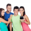Group of friends looking a photo — Stock Photo