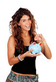 Casual girl with a blue piggy-bank — Stockfoto