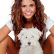 Happy girl with her dog isolated — Stock Photo