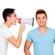 Young men screams to his friend through a megaphone — Stock Photo