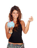 Casual girl with a blue piggy-bank — Stock Photo