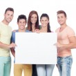 Group of young people with a blank placard — Stock Photo