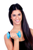 Happy brunette girl toning the muscles — Stock Photo