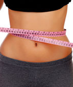Woman waist with measuring tape — Stock Photo