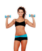 Beautiful woman do toning exercises with dumbbells — Stock Photo
