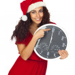 Girl in christmas with a clock with twelve o'clock — Stock Photo