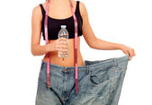 Slim woman back with huge pants and water bottle — Stock Photo