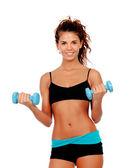Beautiful woman do toning exercises with dumbbells — Stock Photo