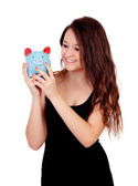 Casual young girl with a blue moneybox — Stockfoto