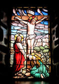 Colorful window with the image of the crucified Jesus — Stock Photo