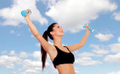 Happy brunette woman toning her muscles — Stock Photo