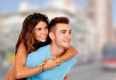 Girl on her boyfriend — Stock Photo