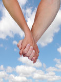 Two hands clasped in love — Stock Photo