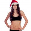 Girl in black underwear and a Santa hat — Stock Photo