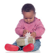 Adorable African American child playing with a gift box — Stock Photo