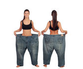 View ahead and behind thin girl with big pants — Stock Photo