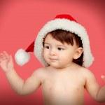 Adorable baby girl with Christmas hat — Stock Photo