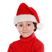 Funny child with Christmas hat in red — Stok fotoğraf