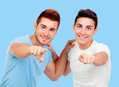 Couple of best friends pointing to the camera — Stock Photo