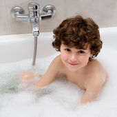 Happy boy at bath time — Stock Photo