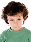 Funny angry child in green — Stock Photo