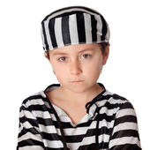 Sad child with with striped prisoner costume — Stock Photo
