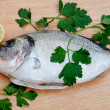 Stock Photo: Healthy fresh fish on wooden board