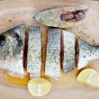 Healthy fresh fish on wooden board — Stock Photo