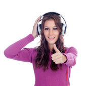 Entertaining girl with headphones listening to music — Stock Photo