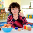 Stock Photo: Painting easter eggs on the school