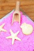 Yellow soaps on pink bath salts — Stock Photo