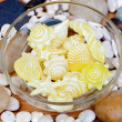 Yellow soaps with shapes of shells and starfish and many little — Stock Photo